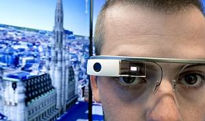 A man wearing Google Glass poses at the Belgiu...