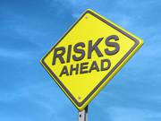 Risks Ahead Yield Sign