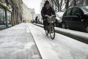 A man rides a Velib bicycle on the slippery st...
