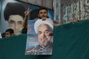 Iranian supporters of President-elect Hassan R...
