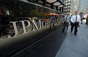 People walk by JP Morgan Chase & Company headq...