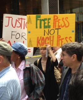 Protesters at a rally opposing a sale of Tribune Co.'s newspapers to the Koch brothers.