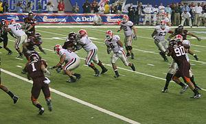 The Virginia Tech Hokies football team and Geo...