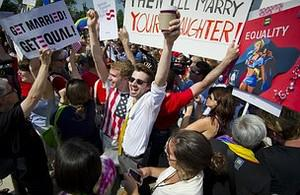 Gay rights activists react outside the US Supr...