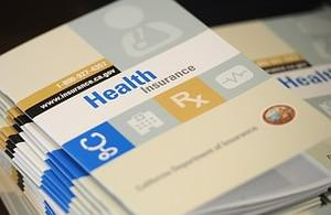 Booklets outlining health insurance options fo...