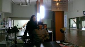 "Jasmine Umagat, Brysen Angeles, and their 8-year-old son, Matteo, at the ""registration desk"" of the... [+] Beacon. The couple run the Beacon break dance studio and the everyday operations of Massive Monkees (photo by Julie Pham)."