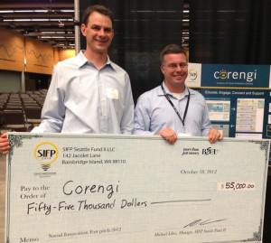 Corengi co-founders Jesse Clark (left) and Ryan Luce holding their prize check for placing second at the Social Innovation Fast Pitch Seattle 2012.