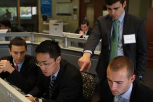 Evan Pete Walsh, Andrew Chan, Vasileios Prassas and Justin Champlain hard at work in the Tozzi trading floor at Ross.  Photo credit:  Kai Petainen