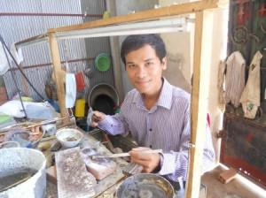 A jeweler with Craftworks Cambodia, an artisan on GlobeIn.com