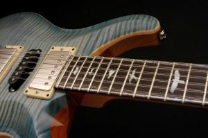 Figured maple top, mahogany back, mother of pearl bird inlays on a rosewood fingerboard, pickups... [+] made in-house.