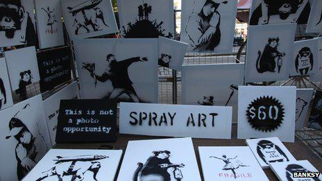 The stall selling original signed Banksy canvases for $60 in New York's Central Park yesterday. (Image source: Bansky)