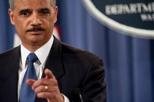 US Attorney General Eric Holder speaks at a pr...