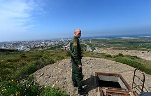 US Border Patrol agent Timothy Hamill stands b...