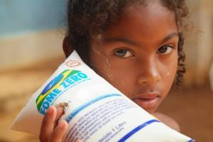 A young girl in northeast Brazil holds up a bag of milk under the Zero Hunger program, part of the... [+] sweeping social welfare program that is now 10 years old in Brazil. An estimated 22 million people were taken out of a dollar a day poverty because of government spending to reduce social inequality.