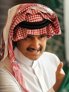 Saudi Prince Alwaleed bin Talal holds a press ...
