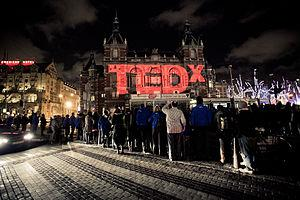 The TEDx logo projected on the Stadsschouwburg