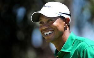 NO COMMERCIAL USE US player Tiger Woods laughs...