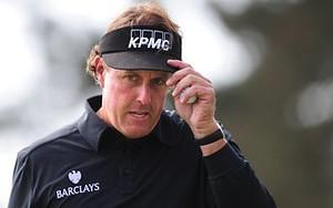 Phil Mickelson of the US gestures after making...