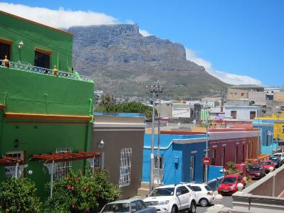 Cape Town's famously pastel Bo-Kaap neighborhood, with omnipresent Table Mountain behind it.