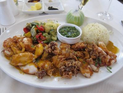 Seafood and Portuguese flavors are common in South Africa, like this calamari piri piri, with a spicy pepper sauce, from a Pretoria eatery.