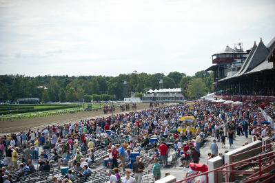 With its general admission grandstands, many picnic tables and cooler-bearing patrons, Saratoga racetrack turns into one big, fun party. Photo: Saratoga Race Track/Adam Coglianese