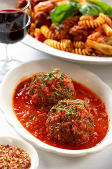 The famed meatballs at Rao's are large, ultra-light and tender and a favorite of many customers... [+] going back decades.