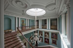 Coote family ancestral portraits hang in the Stair Hall at Ballyfin.