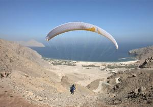 The Ultimate Arrival: Paragliding Down Into Zighy Bay Resort
