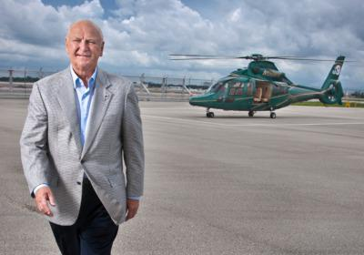 Billionaire Wayne Huizenga at his hangar in Florida, one of his choppers at the rear.