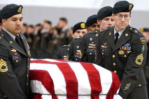 A casket team from the 1st Special Forces Group carries the flag-draped coffin of Sergeant 1st Class Nathan R. Chapman at Seattle-Tacoma International Airport.  Many officials in Washington -- including apparently some congressional leaders -- are too far removed from the human dimensions of the military enterprise to grasp the consequences of the policies they embrace. (U.S. Army Photo)