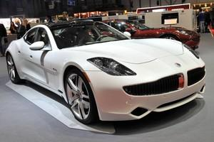 A Fisker Karma hybrid car is displayed at the ...