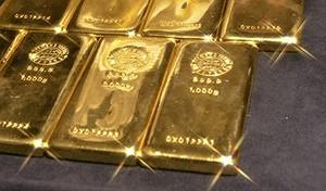 A picture shows 1-kilogram gold bars at the ma...