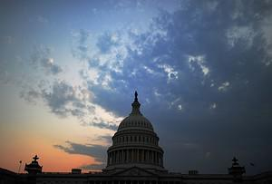 The US Capitol Building is pictured at dusk in...