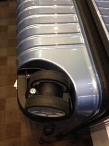 Larger diameter double wheels, such as on this Rimowa case, are preferable to smaller single wheel... [+] construction, for stability of movement over rough surfaces.