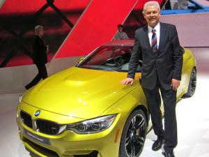 Albert Biermann, vp and head of engineering for BMW's M division, next to the 2015 BMW M4. (Credit: Matthew de Paula)