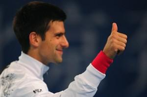 Serbia's Novak Djokovic gestures a thumbs up t...
