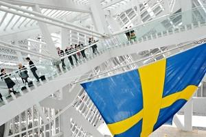 A large Swedish national flag is displayed at ...