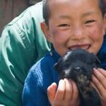 A Brokpa, Eastern Himalayan Boy and His Family Dog, © M. C. Tobias