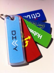 Key tags for some of the country's bike sharing programs. Photo via Divvy Bikes