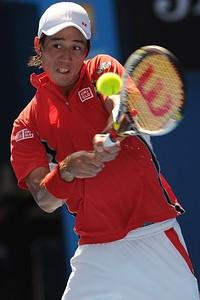 Kei Nishikori of Japan plays a stroke during h...
