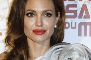 US actress and director Angelina Jolie poses o...