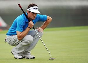 Keegan Bradley of the US lines up his putt at ...