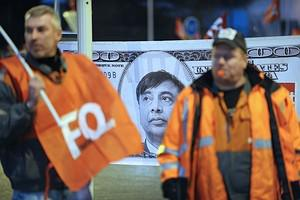ArcelorMittal's workers demonstrate in front o...