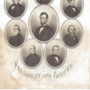 Scan of an antique engraving showing President Abraham Lincoln and his cabinet. It has water damage at the bottom after a flood damaged the box in which it was kept in the owner's basement