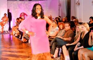 Gwen DeVoe walks the runway at the Curves for a Cure celebrity showcase.