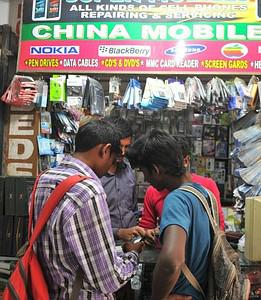Indian shopers look at China Mobile phones in ...