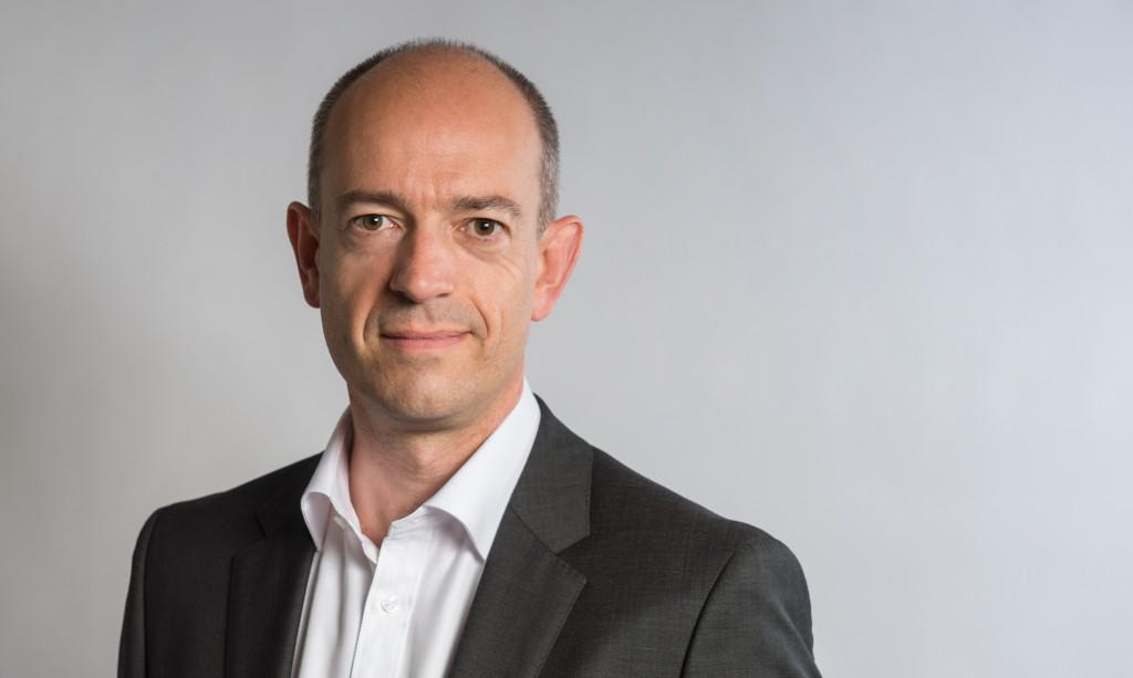 "ARM's chief executive Simon Segars - ""The key is we're a licensing company."" photo via ARM / Fiona Hanson"