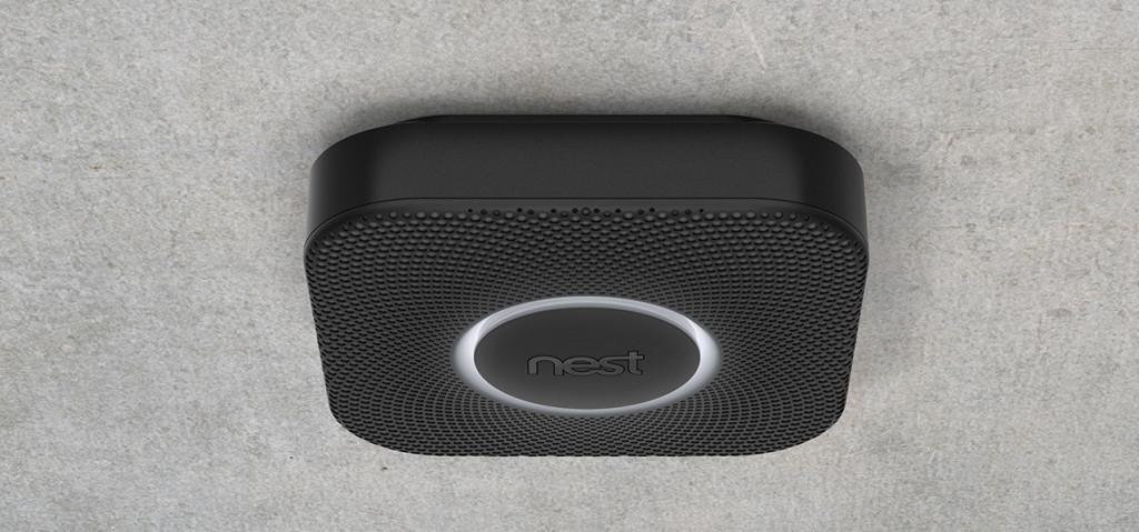 A black Nest Protect; sensors on the smoke alarm cause it to light up when someone walks underneath it in the dark; image via Nest Labs