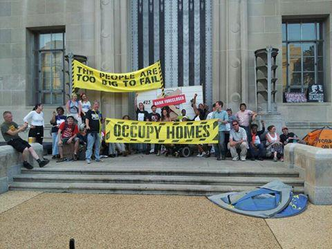 The occupation is still going strong. Here's what the front of the Department of Justice looks like right now!