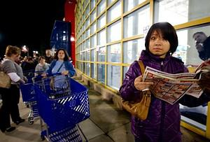 A Black Friday shopper checks out the store fl...